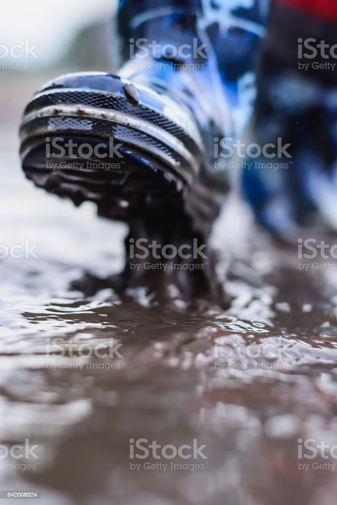Rubber boots are a pool in the summer stock photo