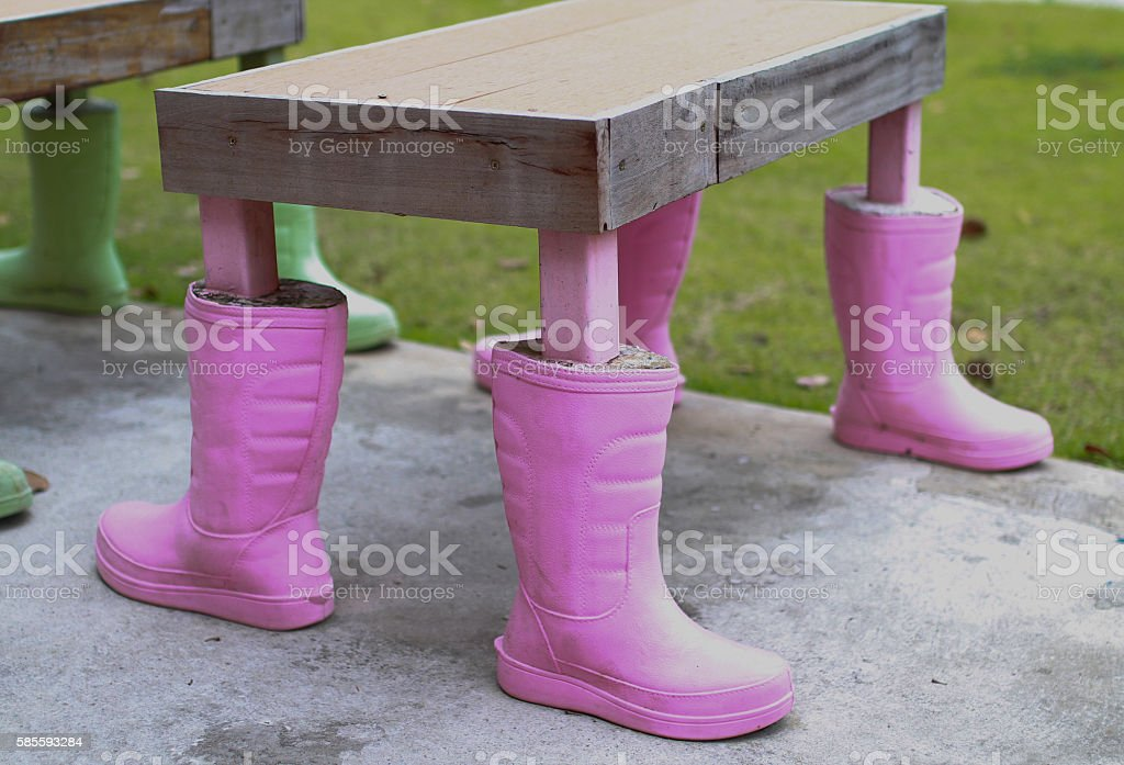 Rubber boots are used to make table legs. stock photo