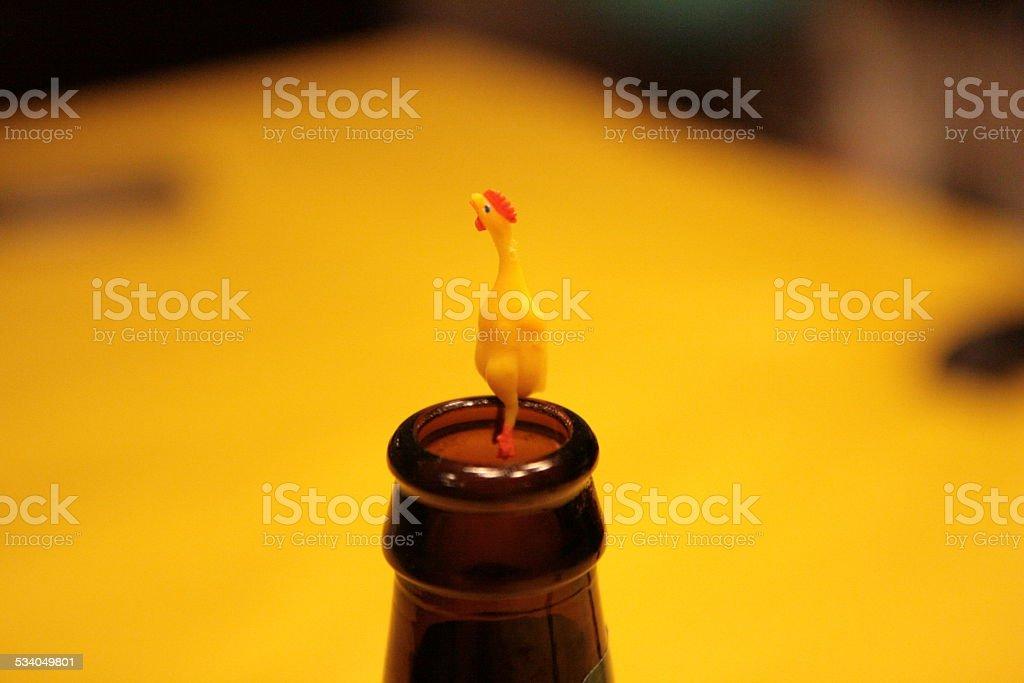 Rubber Chicken On Beer Bottle stock photo