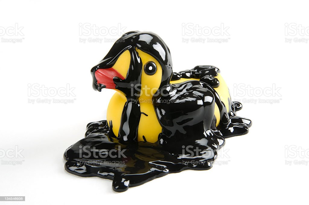 rubber duck covered in oil royalty-free stock photo