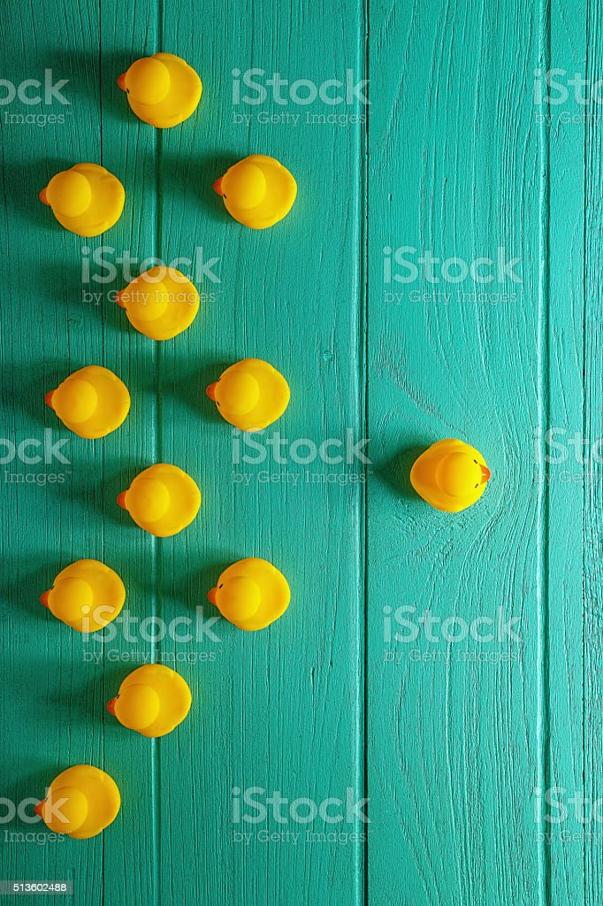 Rubber ducks on an old wooden background. stock photo