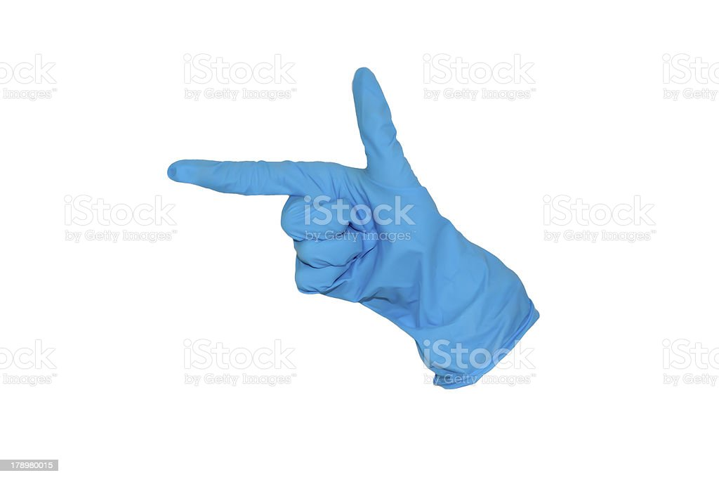 Rubber glove forming a gun royalty-free stock photo