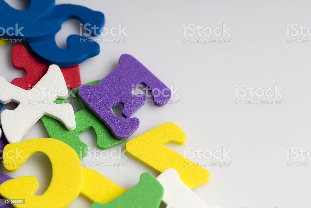 Rubber letters and shapes on white background, close-up royalty-free stock photo
