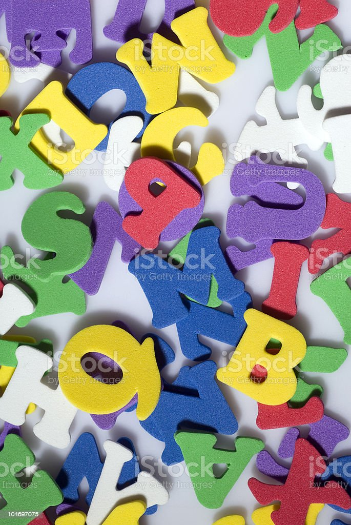 Rubber letters and shapes on white background,close-up royalty-free stock photo