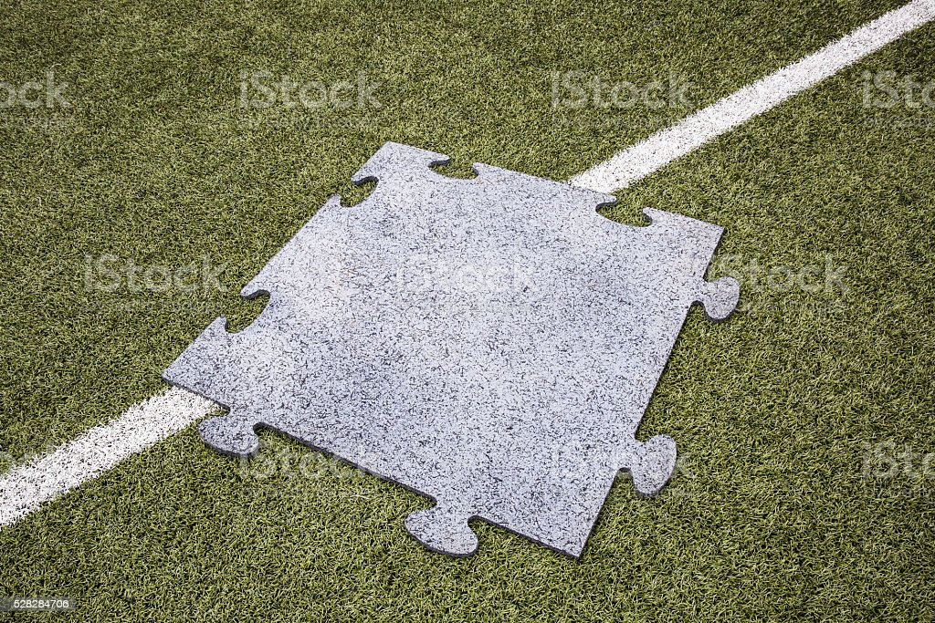 rubber protection for football and soccer field stock photo