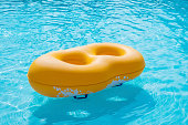 Rubber ring yellow floating in the pool