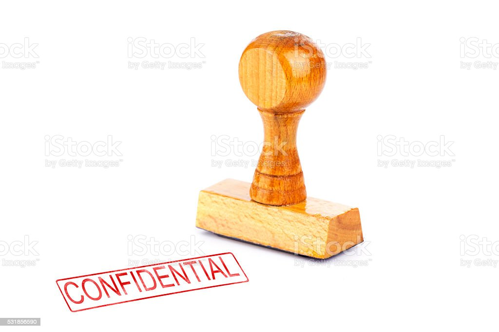 Rubber stamp confidential stock photo