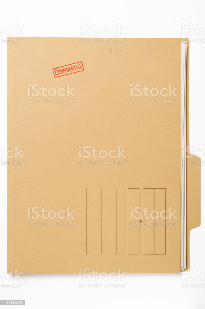 'CONFIDENTIAL' rubber stamp on file with documents on white background stock photo