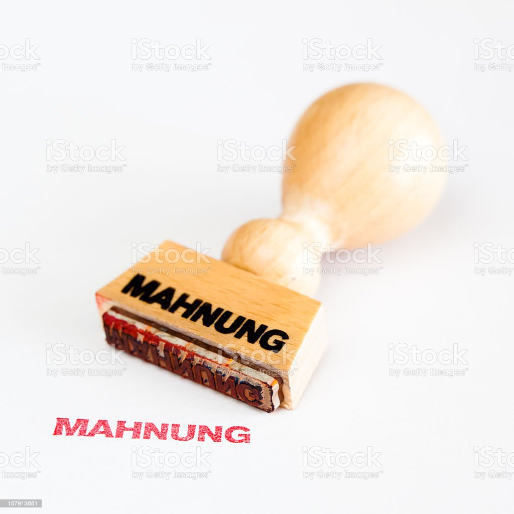 "Rubber Stamp with German text ""Mahnung"" (""reminder"") stock photo"