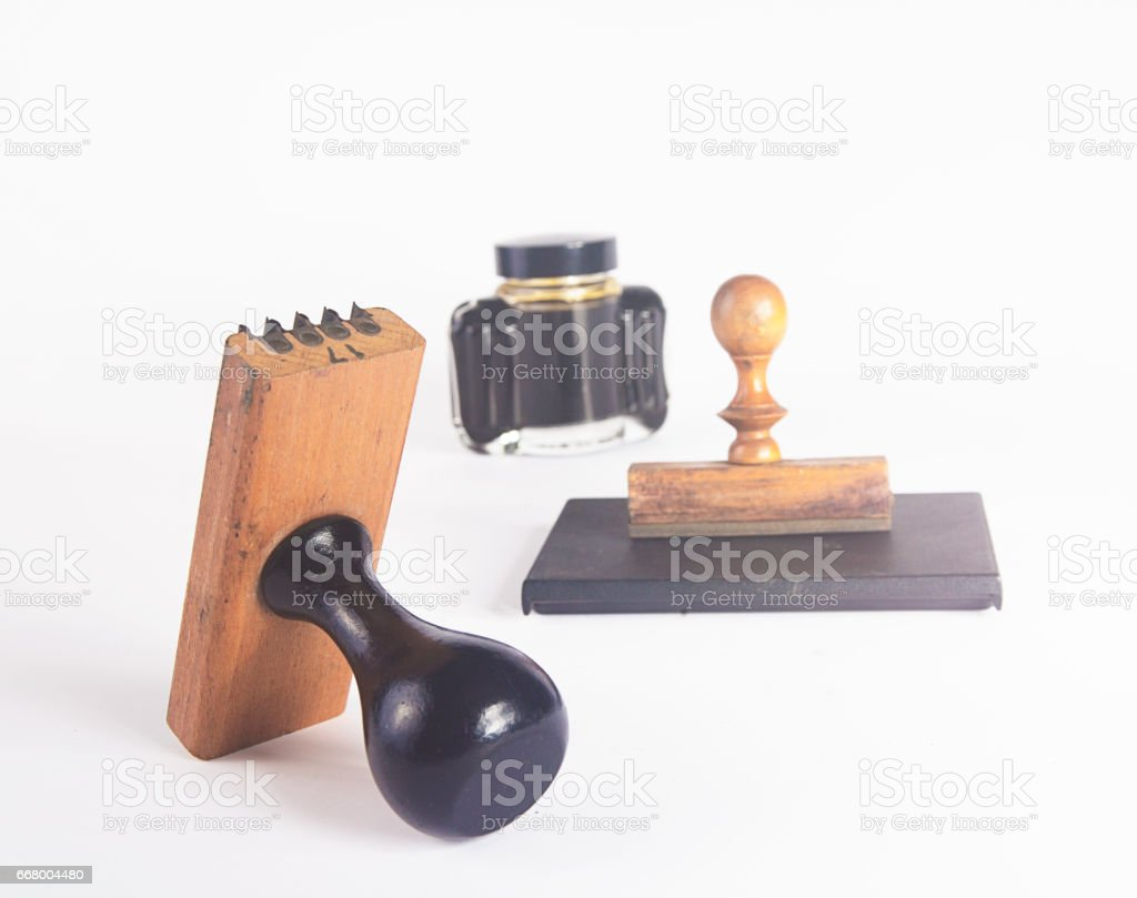 Rubber stamp with pad and ink bottle stock photo