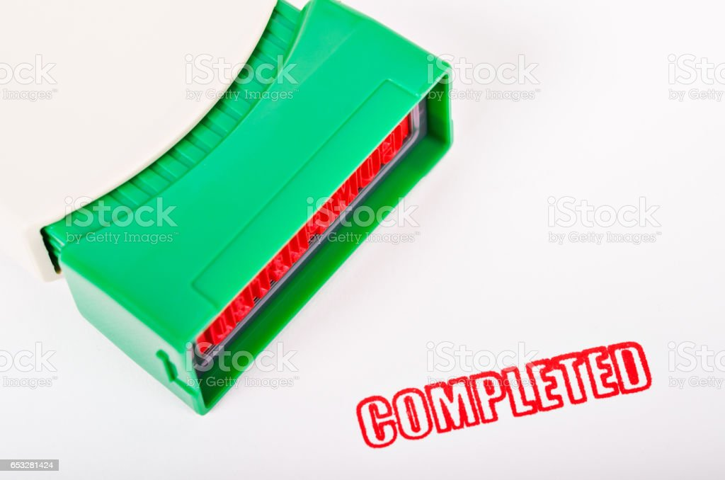 Rubber stamping that says red color completed stock photo