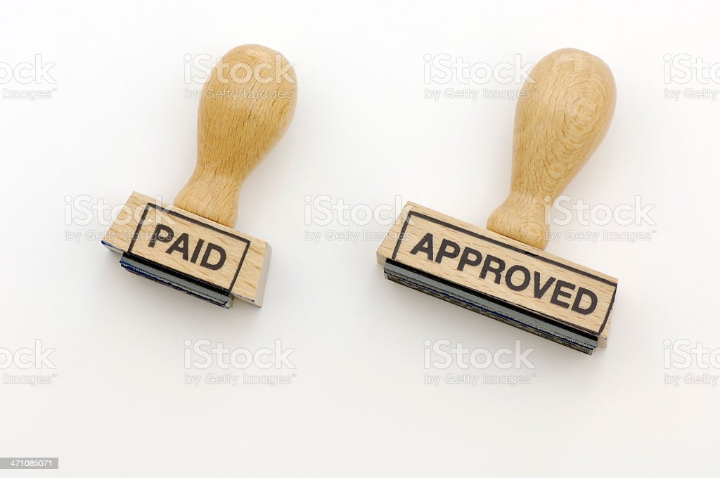 Rubber stamps paid and approved royalty-free stock photo