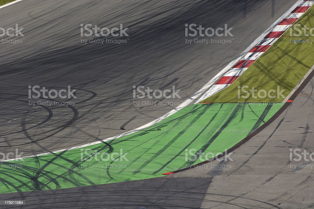 Rubber traces on a race track royalty-free stock photo