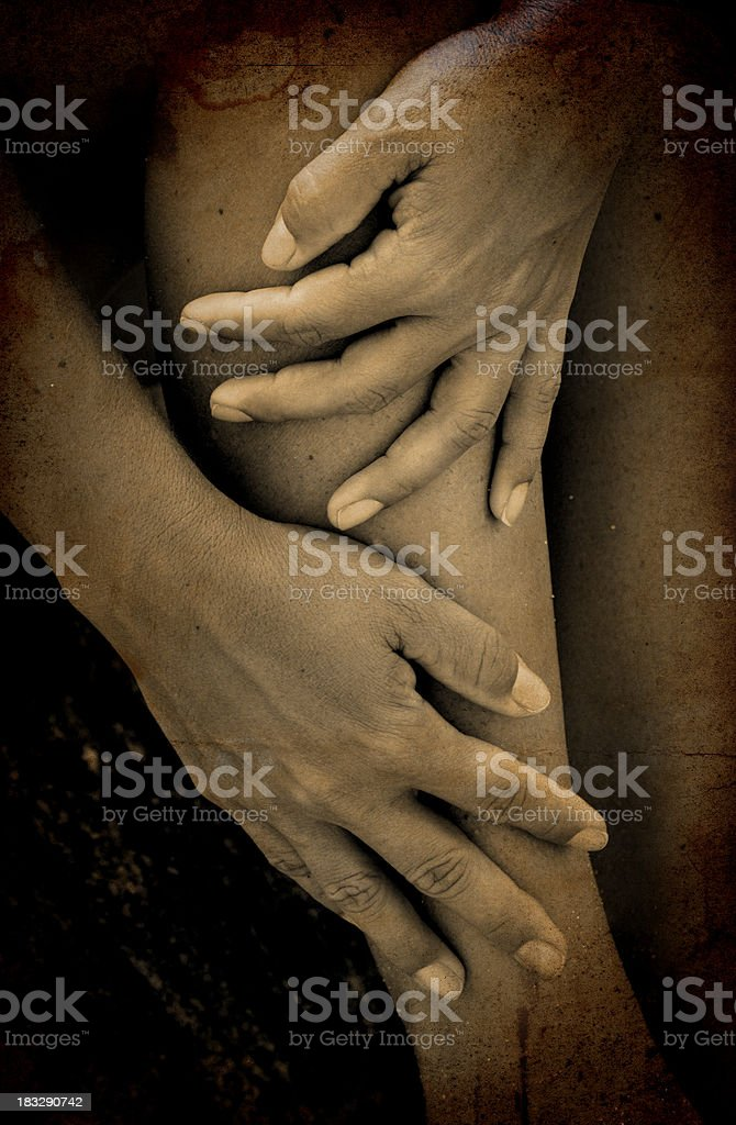 rubbing legs in sepia stock photo
