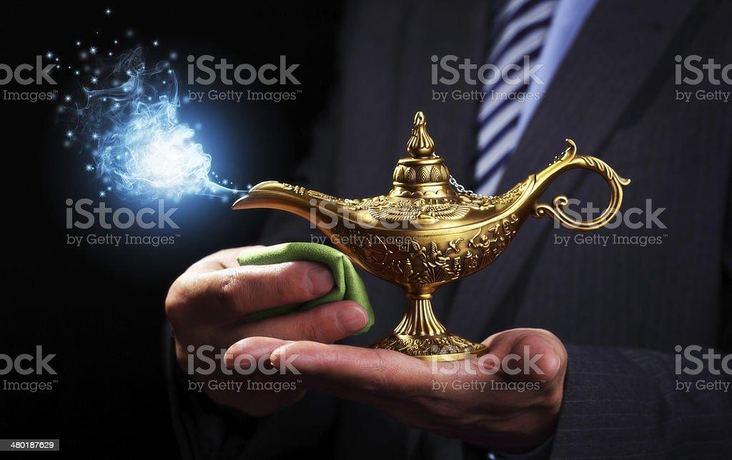 Rubbing magic Aladdins genie lamp stock photo
