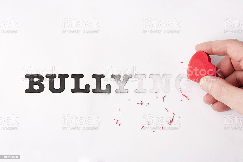 Rubbing out bullying royalty-free stock photo