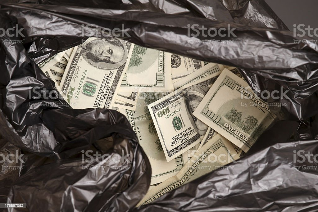 Rubbish bag with dollars. stock photo