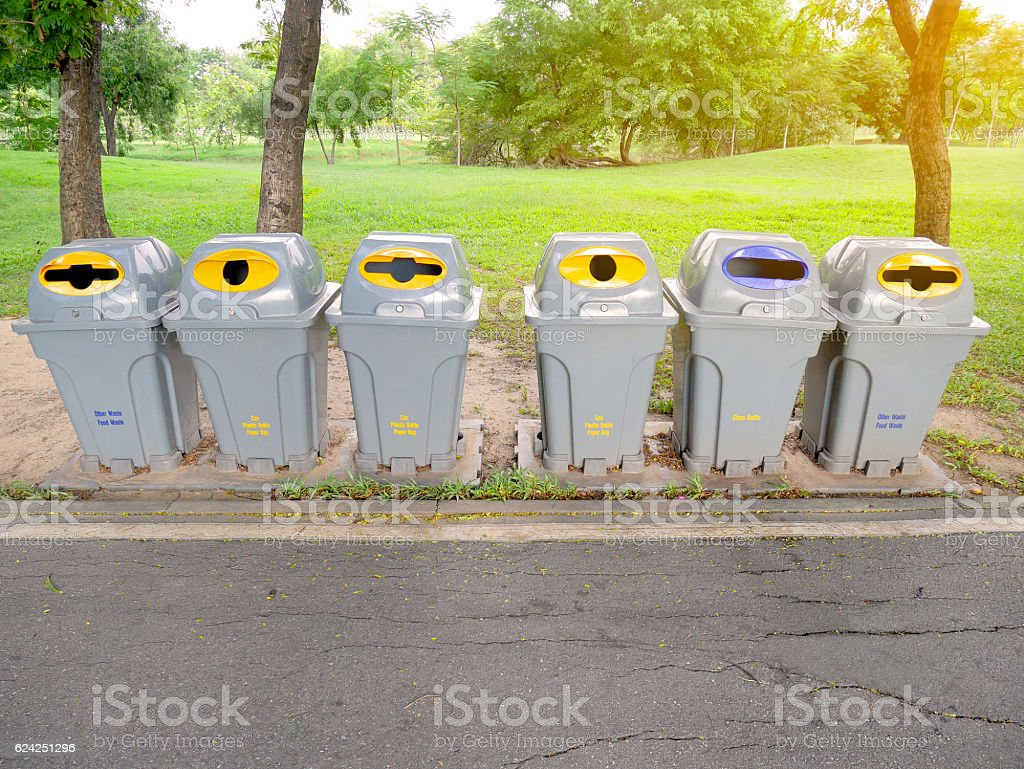 Rubbish bins in the park. Different types of trash. stock photo