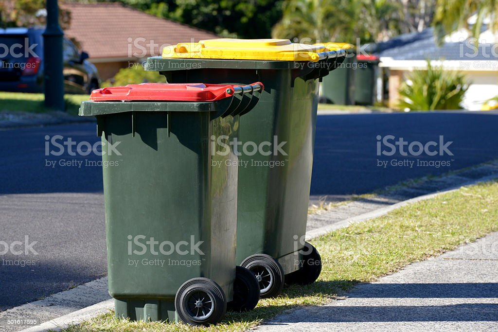 Rubbish bins red lid rubbish and yellow lid is recycling stock photo