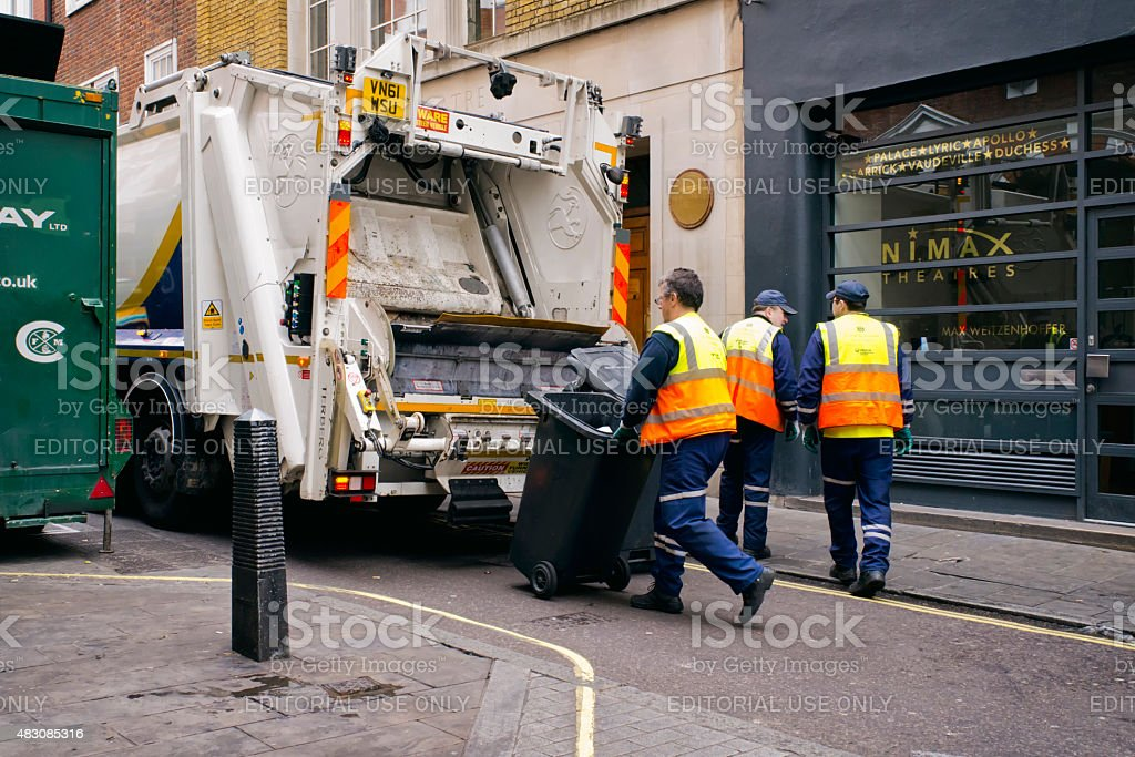 Rubbish collectors working in London stock photo