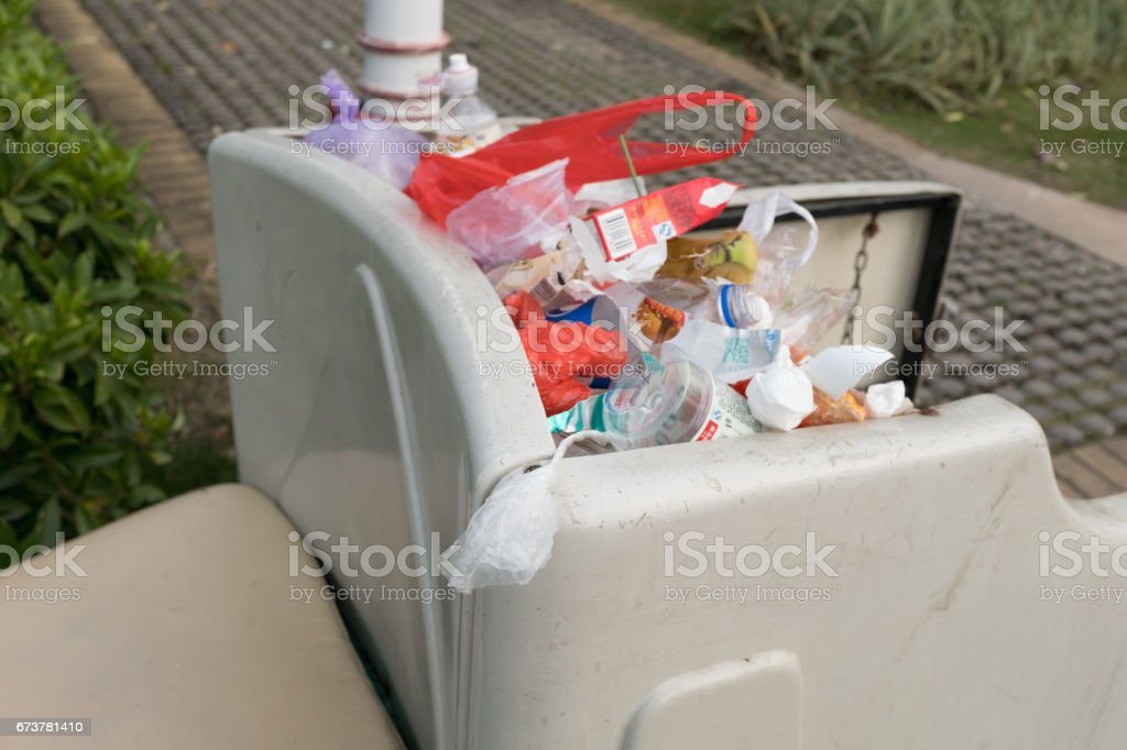 rubbish in trash can stock photo