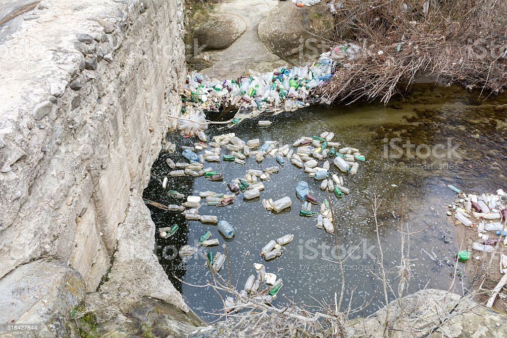 Rubbish pollution with plastic and other packaging stuffs in the stock photo