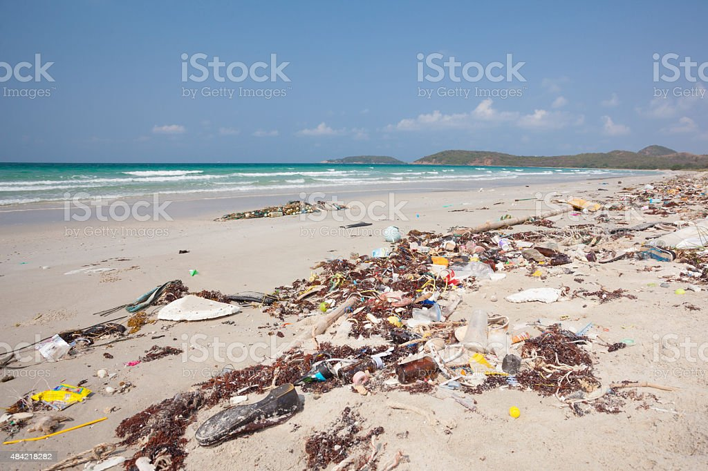 Rubbish washed up on the shore on the beach stock photo