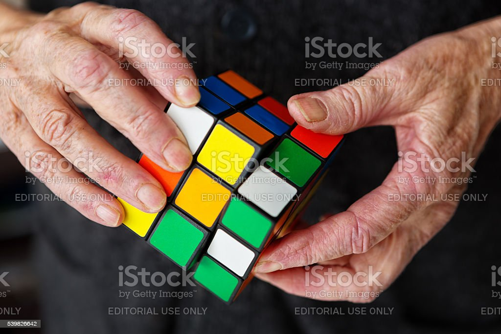 Rubiks Cube, problem solving, aging, frustration, confusion, mental health, puzzle, stock photo