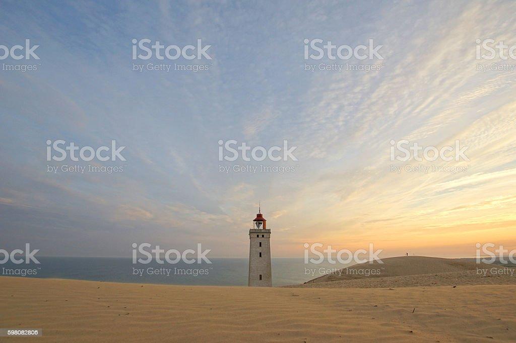 Rubjerg Knude Lighthouse shortly after sunrise stock photo