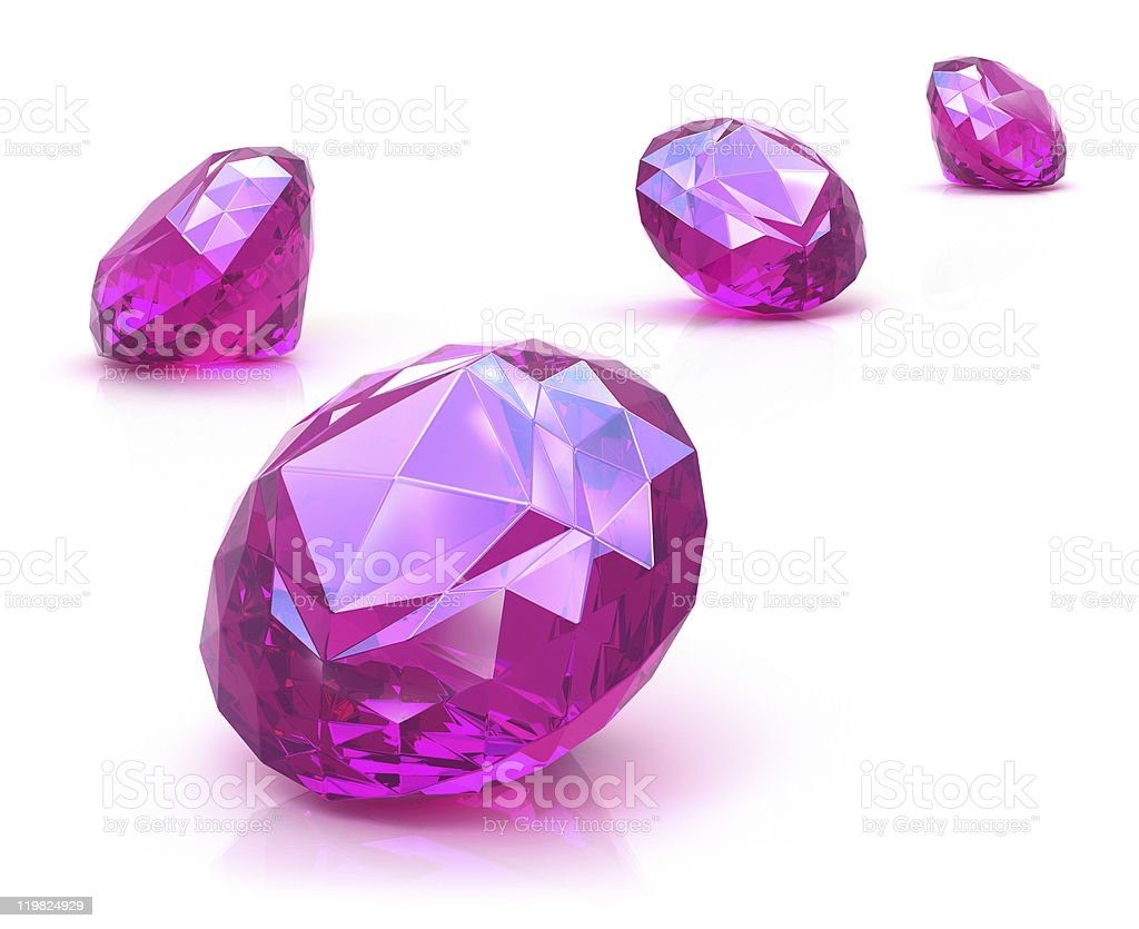 Ruby gemstones on white surface royalty-free stock photo