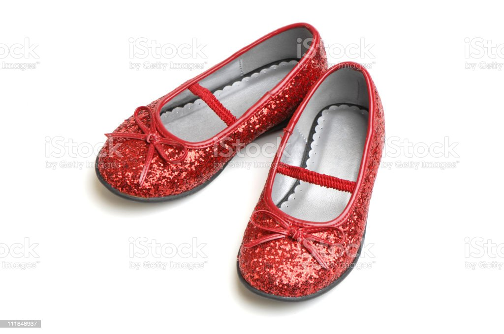 Ruby Slippers Little Girl Shoes Isolated on White Background stock photo