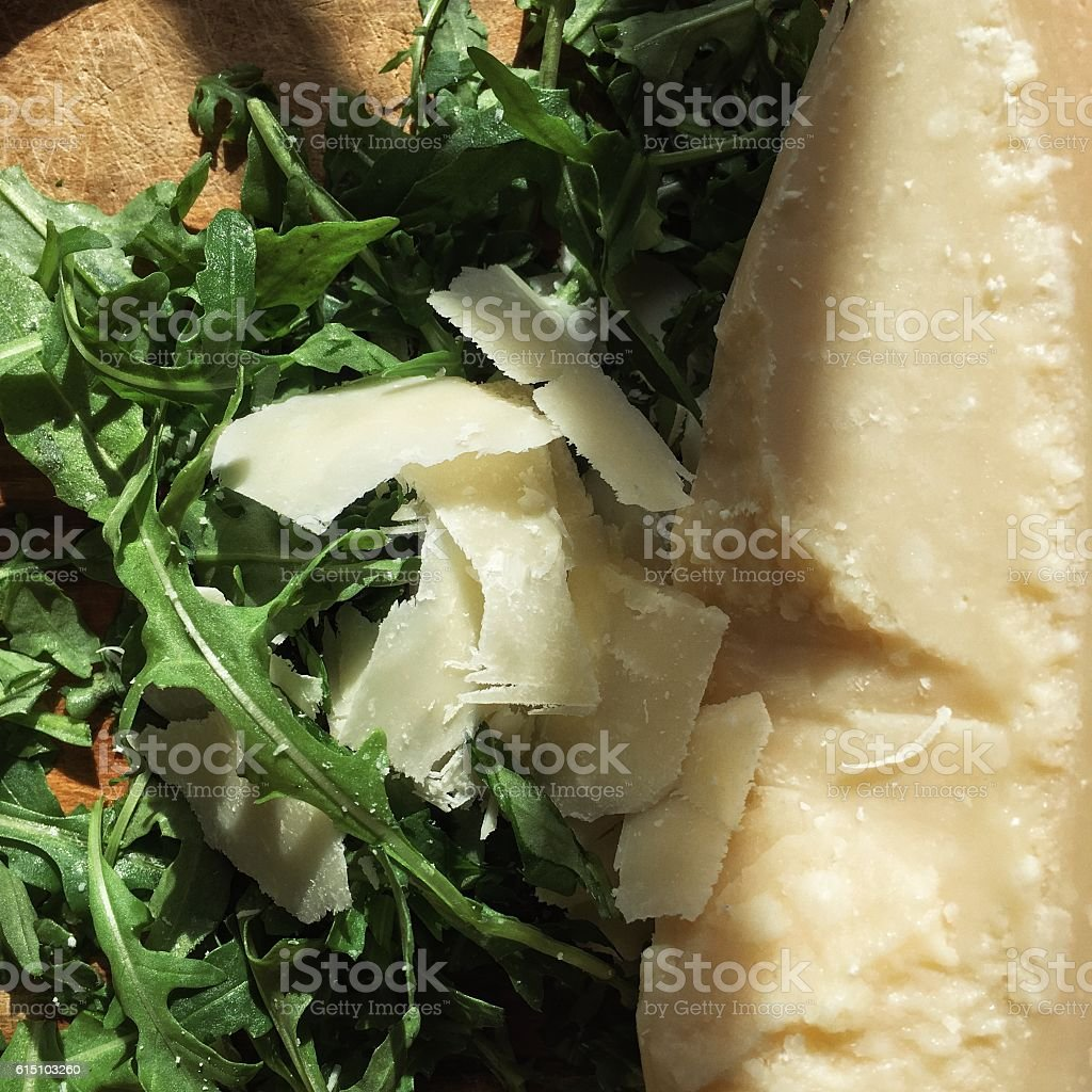 Rucola and cheese stock photo