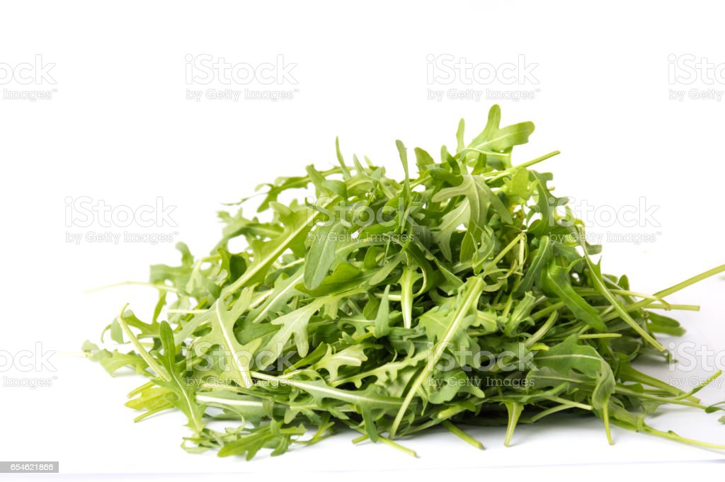 Rucola plant green leaves isolated stock photo