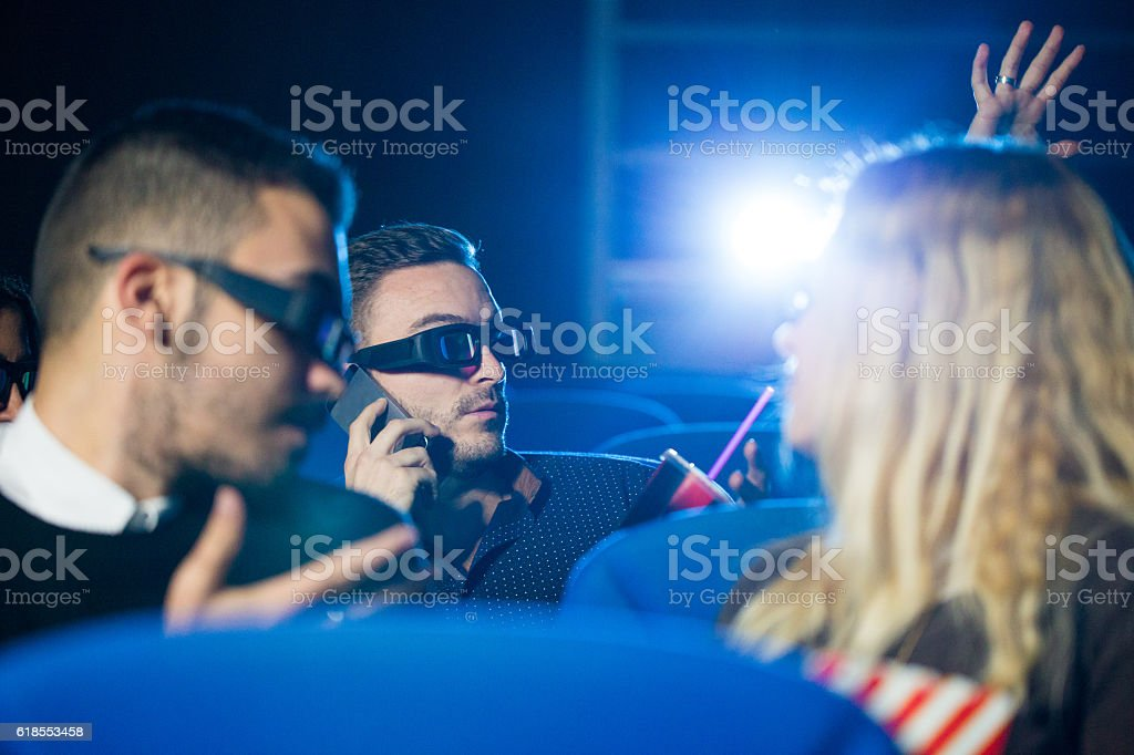 Rude at  the movie theater stock photo