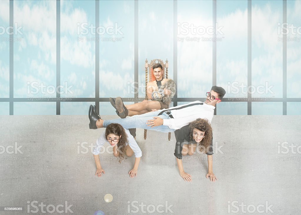 rude boss put foot on human desk stock photo