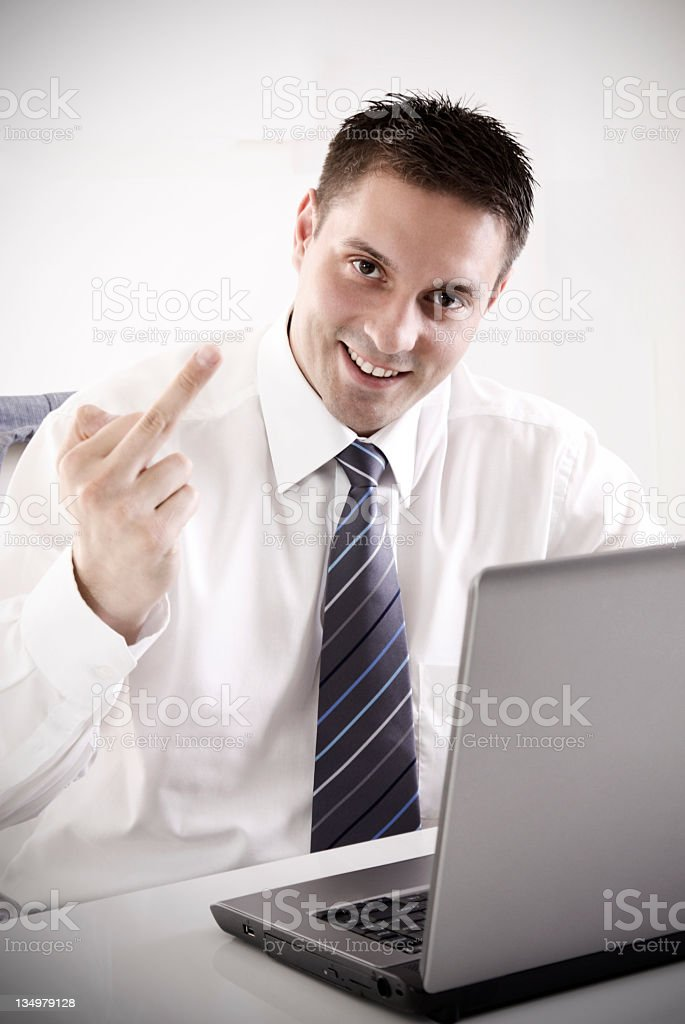 rude businessman showing middle finger royalty-free stock photo