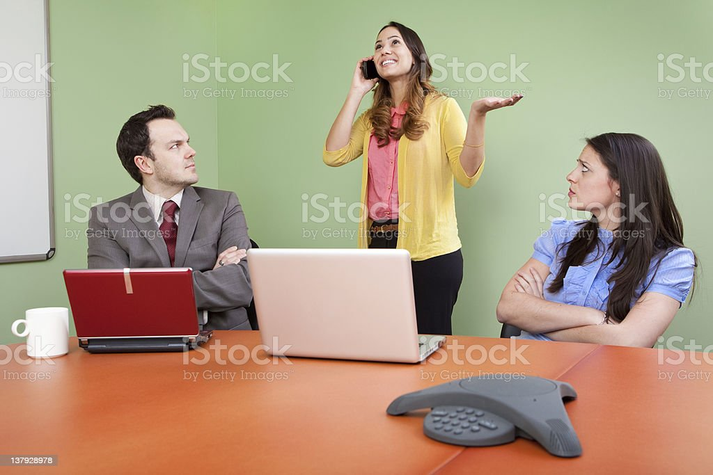 Rude colleague talking on phone stock photo