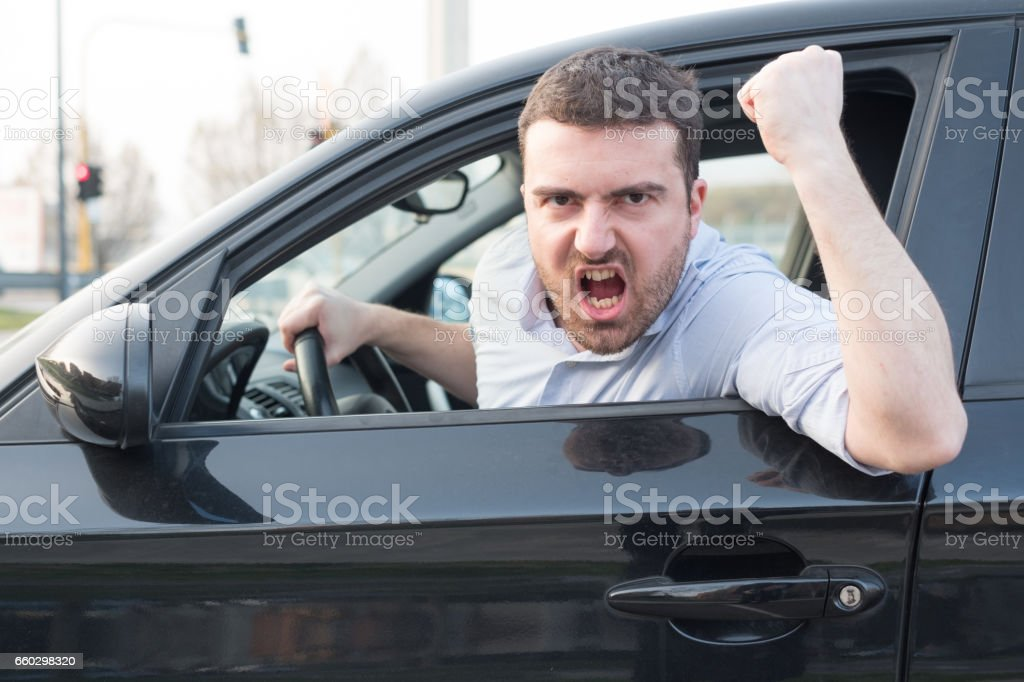 Rude man driving his car and arguing stock photo
