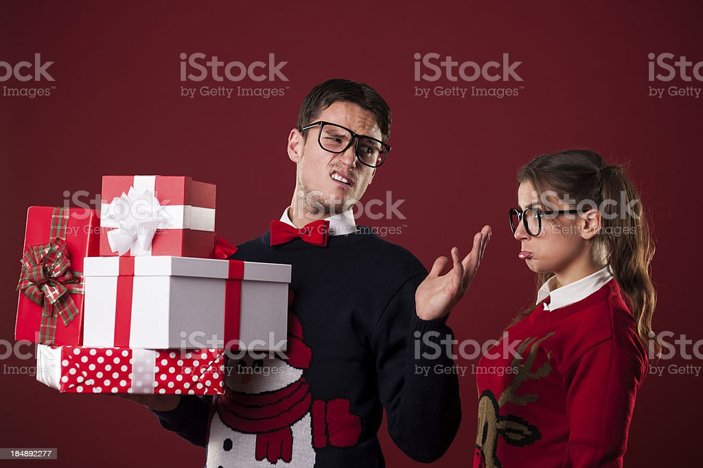 Rude nerdy man with christmas gifts royalty-free stock photo