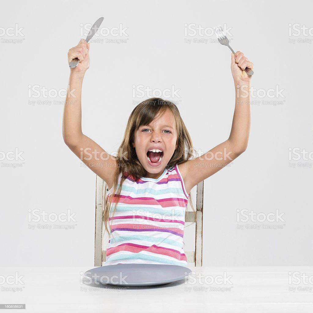 Rude screaming child at dinner royalty-free stock photo