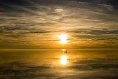 Ruderboot im Sonnenuntergang