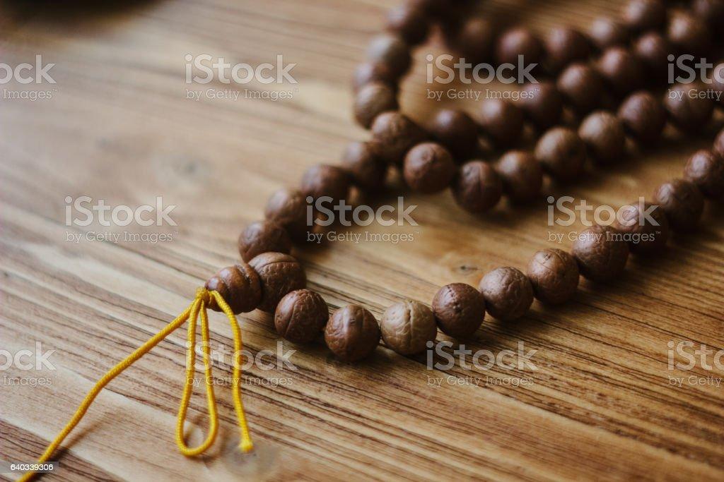 Rudraksha japa mala. Rosary made from rudraksha seeds. stock photo