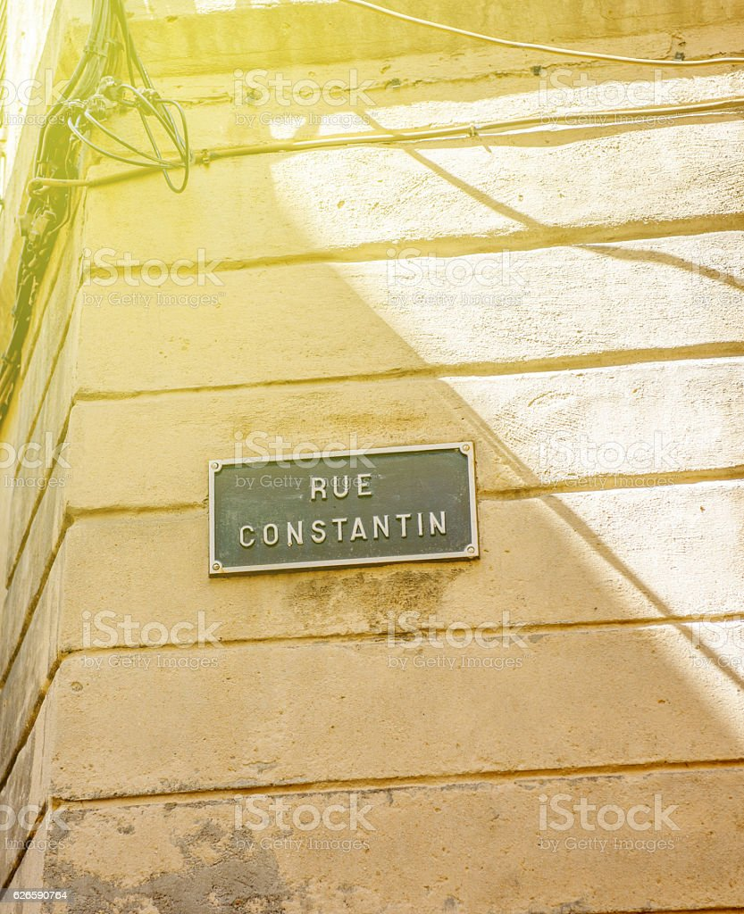 Rue Constantion or Constantin street sign sunny day stock photo