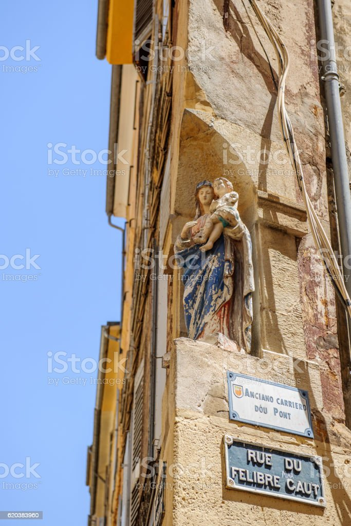 Rue de Felibre Caut with Religious staute Maria with Jesus stock photo