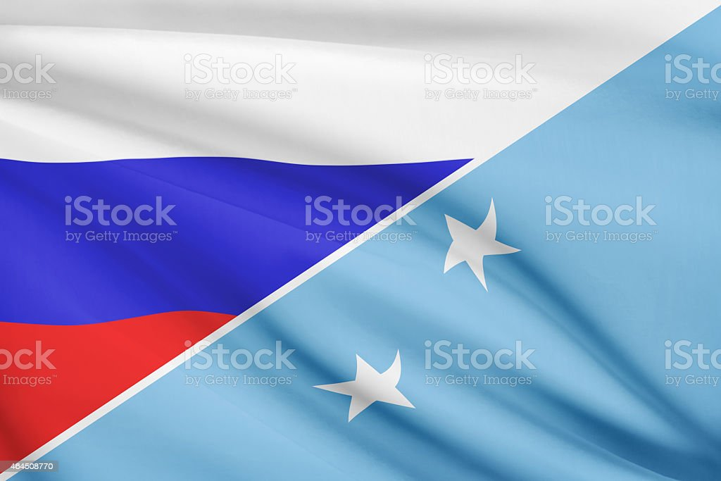 Ruffled flags. Russia and Federated States of Micronesia. stock photo