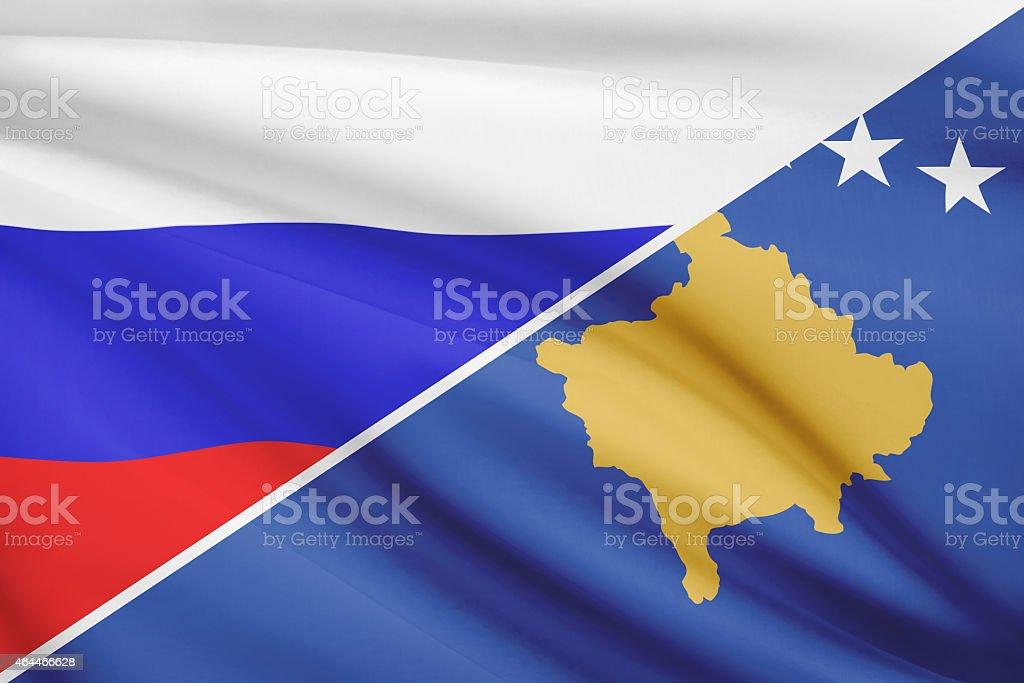 Ruffled flags. Russia and Republic of Kosovo. stock photo