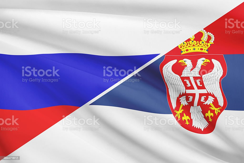 Ruffled flags. Russia and Republic of Serbia. stock photo