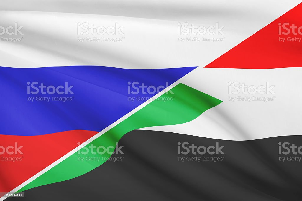 Ruffled flags. Russia and Republic of the Sudan. stock photo