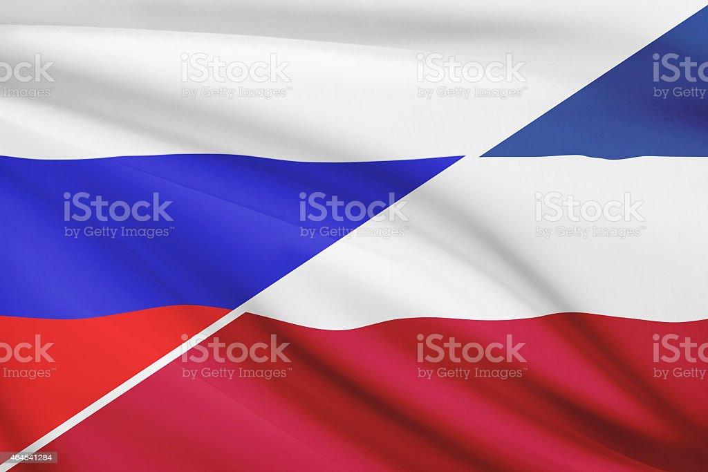 Ruffled flags. Russia and Socialist Federal Republic of Yugoslavia. stock photo