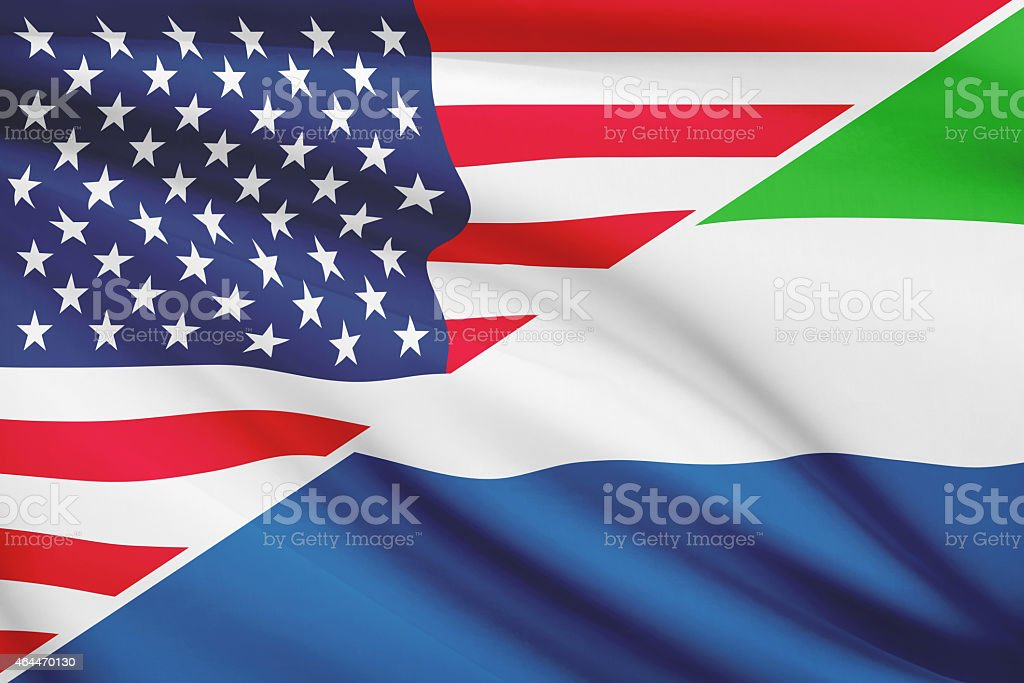 Ruffled flags. USA and Republic of Sierra Leone. stock photo